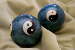 A pair of stress balls. Over a delicate velvet. Oriental culture stock image