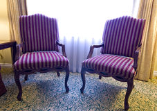 Pair of striped fabric chairs Stock Photos