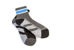 A pair of striped socks. On a white background Royalty Free Stock Photography
