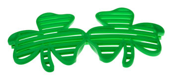 St. Patrick's Funky Clover Striped Sunglasses. A pair of striped sunglasses shaped as to clover leaves, great accessory for St. PAtrick's Day celebrations Royalty Free Stock Image