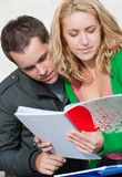 A pair of students. Read the notebook Royalty Free Stock Photos