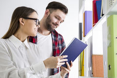 Pair of students in a library Stock Image