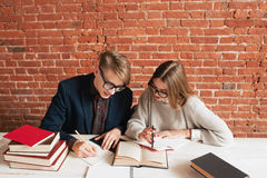 Pair of students studying at library free space Stock Image