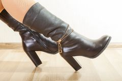 Boots. A pair of stylish boots on beautiful female legs Royalty Free Stock Images