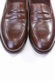 Pair of Stylish Brown Penny Loafer Shoes Royalty Free Stock Image
