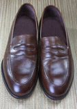 Pair of Stylish Expensive Modern Calf Leather Brown Penny Loafer Shoes Royalty Free Stock Photos