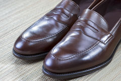 Pair of Stylish and Fashinable Brown Penny Loafer Shoes. Stock Photography