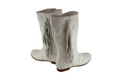 Pair of stylish female white leather boots. Isolated royalty free stock images