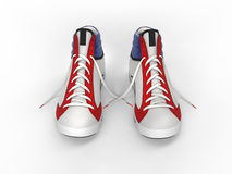 Pair of stylish modern sneakers - front top view Royalty Free Stock Photography