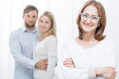 Pair after successful marital therapy. Picture of psychologist and pair after successful marital therapy Stock Photos