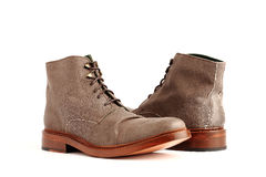 Pair of suede boots Royalty Free Stock Photos