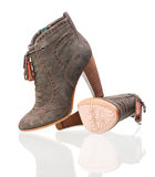 Pair of suede high heels boots over white Royalty Free Stock Photography