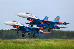 Pair of Sukhoi Su-27 of Russian Knights aerobatics team jet fighters take off at Kubinka air force base. KUBINKA, MOSCOW REGION, RUSSIA - JUNE 3, 2011: Pair of Stock Photo