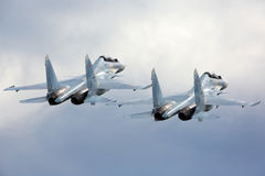 Pair of Sukhoi Su-30SM RF-91815 jet fighters take off at Kubinka air force base during Army-2015 forum. KUBINKA, MOSCOW REGION, RUSSIA - JUNE 17, 2015: Pair of Stock Image