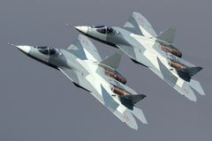 Pair of Sukhoi T-50 PAK-FA 052 BLUE and 051 BLUE modern russian jet fighters performing demonstration flight in Zhukovsky. Zhukovsky, Moscow Region, Russia Stock Photos