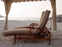 Pair of sun loungers on beach Royalty Free Stock Images