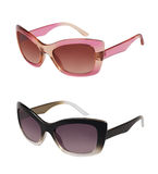 Pair of sunglasses in different colors Royalty Free Stock Images