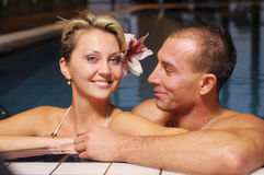 The pair in swimming pool Royalty Free Stock Photography