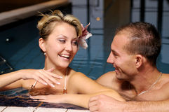 The pair in swimming pool Stock Photo