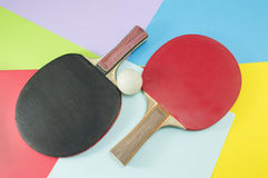 Pair of table tennis rackets on a collage background Stock Images