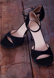Pair of tango shoes on worn out wooden floor Stock Photo
