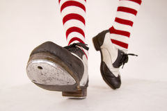 Pair of tap shoes. Pair of black and white tap shoes with red and white striped socks Stock Photography
