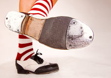 Pair of tap shoes. Pair of black and white tap shoes with red and white striped socks Royalty Free Stock Photo