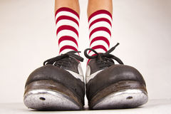 Pair of tap shoes. Pair of black and white tap shoes with red and white striped socks Royalty Free Stock Photography