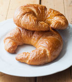 A pair of tasty fresh croissants Stock Image