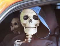 A Pair of Teen Skeletons Sitting in Traffic Stock Images