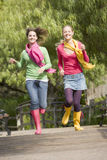Pair Of Teenage Girls Jogging In Park Royalty Free Stock Photos