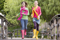 Pair Of Teenage Girls Jogging In Park Stock Photo