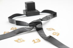 Pair of tefilin and Tallit A symbol of the Jewish people, a pair of tefillin with black straps, isolated on a white background, wi Stock Photos