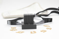 Pair of tefilin and Tallit A symbol of the Jewish people, a pair of tefillin with black straps, isolated on a white background, wi Stock Image