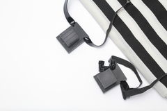 Pair of tefillin , A symbol of the Jewish people, a pair of tefillin with black straps, isolated on a white background. Pair of tefilin and Tallit A symbol of Royalty Free Stock Image