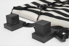 Pair of tefillin , A symbol of the Jewish people, a pair of tefillin with black straps, isolated on a white background. Pair of tefilin and Tallit A symbol of Royalty Free Stock Photos