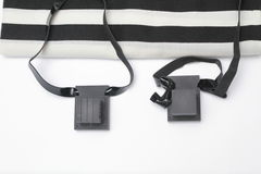 Pair of tefillin , A symbol of the Jewish people, a pair of tefillin with black straps, isolated on a white background. Pair of tefilin and Tallit A symbol of Stock Photography