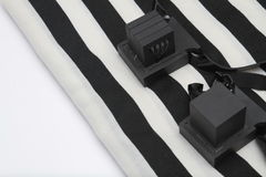Pair of tefillin , A symbol of the Jewish people, a pair of tefillin with black straps, isolated on a white background. Pair of tefilin and Tallit A symbol of Royalty Free Stock Photography