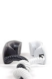 Pair of telephone receivers. Black and white. Royalty Free Stock Image