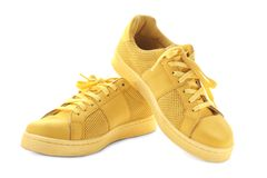 Pair of tennis shoes on background. Pair of tennis shoes on white background Royalty Free Stock Photography