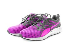 Pair of tennis shoes on background. Pair of tennis shoes on white background Stock Image