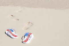Pair of thongs on the beach Stock Photography