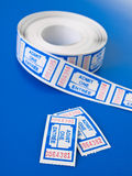 Pair of tickets on techno blue. Background vertical view stock photos