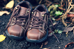 Pair of toddler boots lying on the ground Stock Images