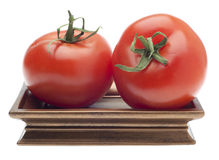 Pair of Tomatoes on a Golden Dish Stock Photos