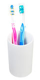 Pair tooth brushes in ceramic glass Royalty Free Stock Images