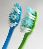 Pair of toothbrushes. One blue one green Stock Images