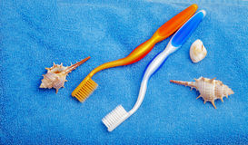 Pair of toothbrushes on blue towel Royalty Free Stock Image
