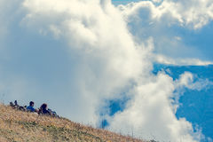 Pair of tourists on the mountain meadow. Stock Photography