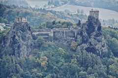 Pair of towers of the castle on rocks in the woods Royalty Free Stock Photo